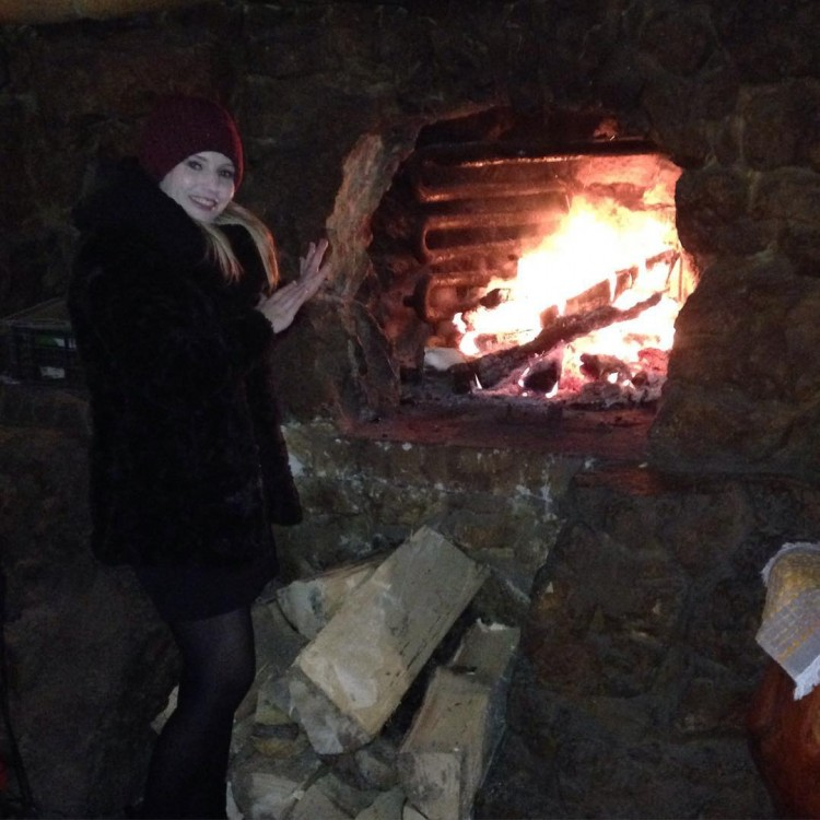 Getting a heat by the fire  fire cosy mountains